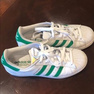White Adidas sneakers with green stripes